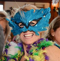 woman wearing mardi gras mask
