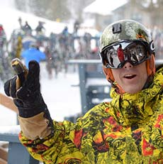 smiling man wearing ski goggles