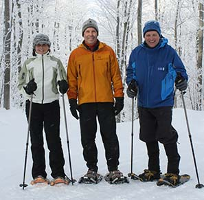 three people snowshoeing